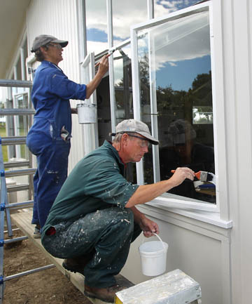 HELPING HANDS: Members for the Mobile Mission Maintenance Team paint the outside of the Timaru Christian school.