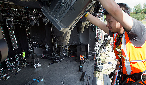 SHINE ON: Lighting technician Shaune Tan rigs up a spotlight at Mystery Creek Mainstage.