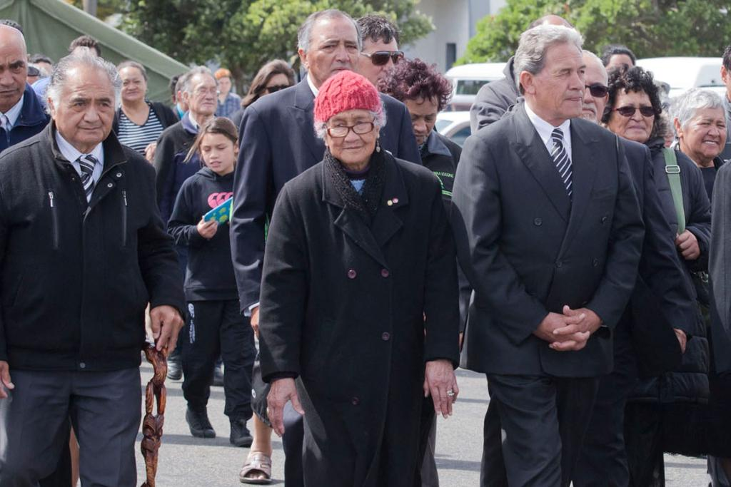 NZ First leader Winston Peters, rights, arrives at Ratana.