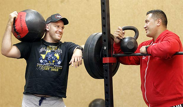 NEW VENTURE: Prop Ben Franks, left, in his new Wellington gym with trainer Cole Lemalu.