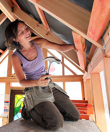 HOUSE ON WHEELS: Lily Duval, 27, is building her own miniature house, despite having no previous building experience.