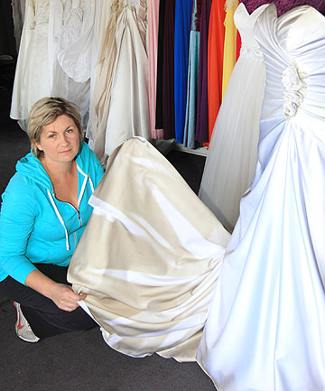 DETERMINATION: 4 Ever After Bridal owner Sarah Barker-McBurney is quietly optimistic there will be no bride without a gown despite the arson attack that left her shop badly smoke-damaged.