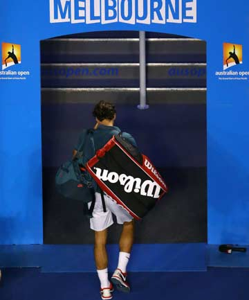 HEADING OUT: Roger Federer heads to the exit at Rod Laver Arena after his loss to Rafa Nadal in the Australian Open semifinals.