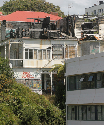 SOON TO BE GONE: The burned-out derelict house on Allenby Tce in central Wellington will soon be demolished, having been wrecked since a 2009 fire. Why did it take so long to do something about it?