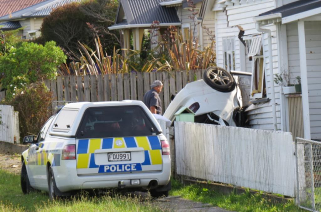 The scene of a crash in Greymouth where one person died and two others were injured after the car they were in smashed into a house.