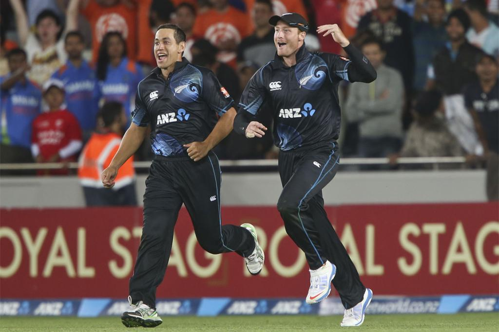 Ross Taylor (left) and Martin Guptill celebrate a wicket in the third ODI.