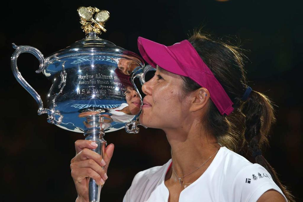 THIRD TIME LUCKY: Li Na kisses the Daphne Akhurst trophy after defeating Dominika Cibulkova in the Australian Open final.