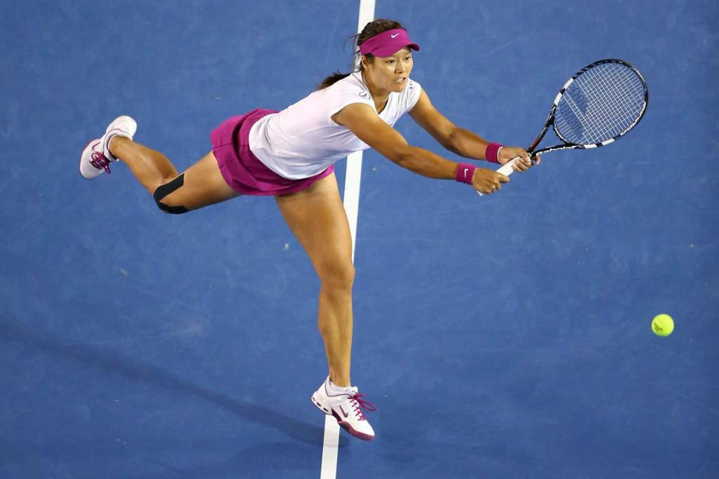 Li Na stretches for a two-handed volley in the women's final.