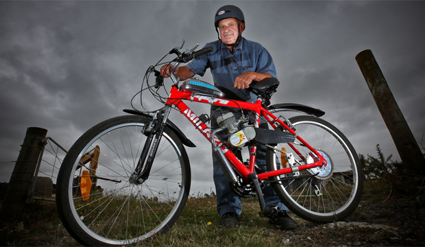 PEDAL PLUS POWER: John Mann with one of his motorised bikes which sometimes fall foul of the law.