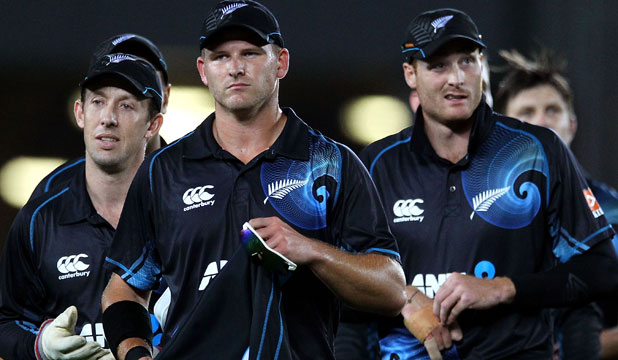 LET DOWN: Corey Anderson, Luke Ronchi and Martin Guptill walk off the field with a touch of regret after India's comeback led to a dramatic tie in Auckland.