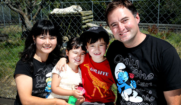 HAPPY FAMILY: Xincai Liu and Adam Can Horne sit with their kids, Maya Horne, 3, and Cengiz Horne, 6, at the Pouakai Zoo.