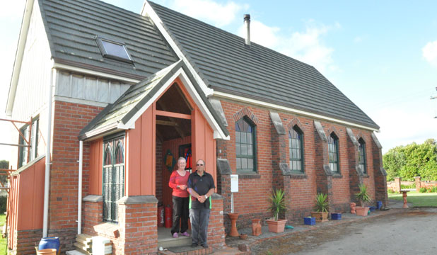HOME SWEET CHURCH: Bruce and Gail Thompson enjoy the peace and quiet of their converted church.