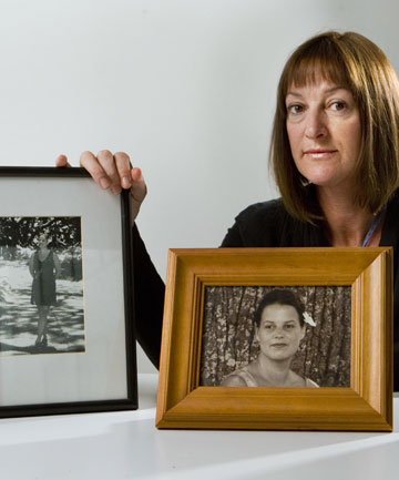 Sara Andrews with pictures of her sister, Michelle Mary Andrews