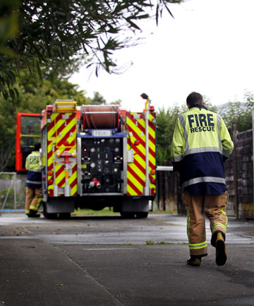 Firefighters at the scene of a suspicious fire in Waitara.