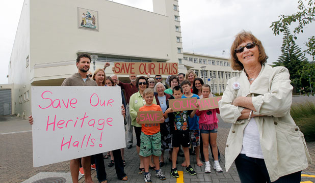 OUR HALL: Jenny Sands stands with supporters seeking the retention of two heritage halls in Lower Hutt.