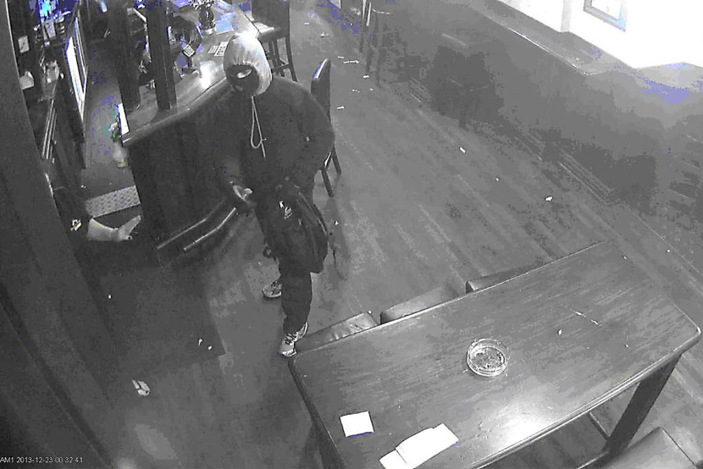 CCTV FOOTAGE: One of armed robbers was caught on a security camera at The Craic.