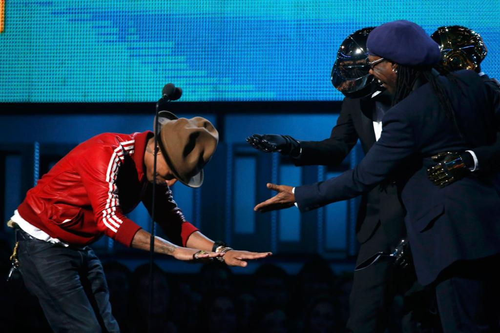 Producer Pharrell Williams bows to Daft Punk and Niles Rogers after winning the award for Best Pop Duo/Group Performance.