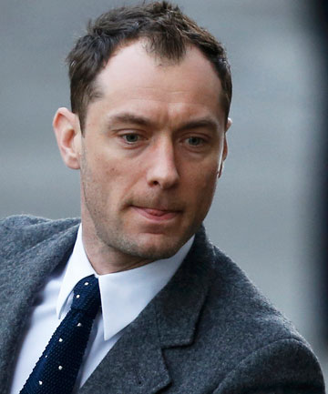 WITNESS: Jude Law arrives at court to give evidence in the phone-hacking trial of Rebekah Brooks.
