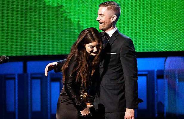 PROUD MOMENT: Producer Joel Little hugs Lorde after they accepted the award for Song of the Year.