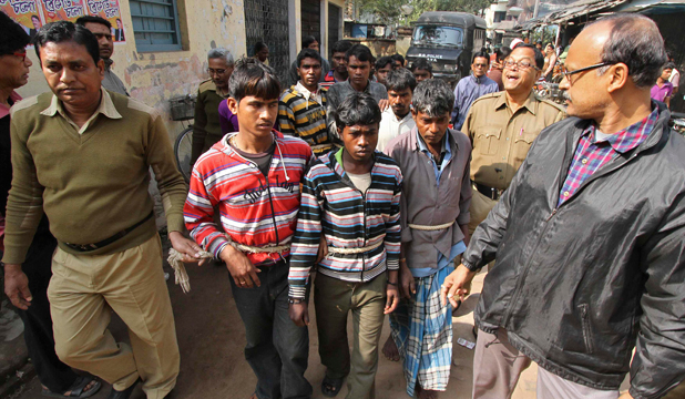 Indian police personnel escort men (tied with rope) who are accused of a gang-rape, to a court in the eastern Indian state of West Bengal last week.