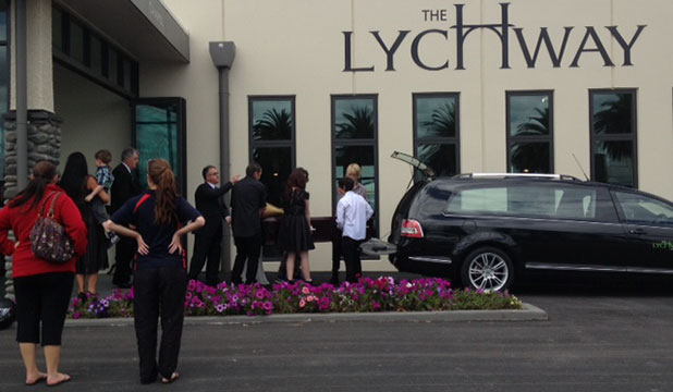 FAREWELLED: Mourners at Harley Vivian-Fletcher's funeral carry in his coffin to the service.
