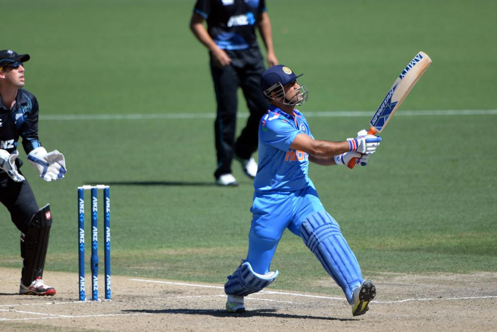 MS Dhoni launches into a big shot in the fourth ODI in Hamilton.