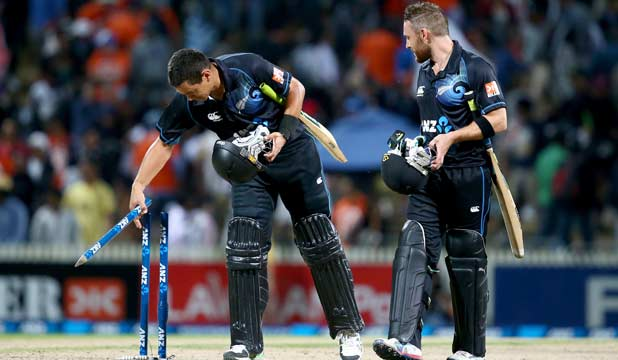 TAKING THE SPOILS: Ross Taylor removes a stump as the Black Caps secured the one-day series with India after victory in the fourth match.