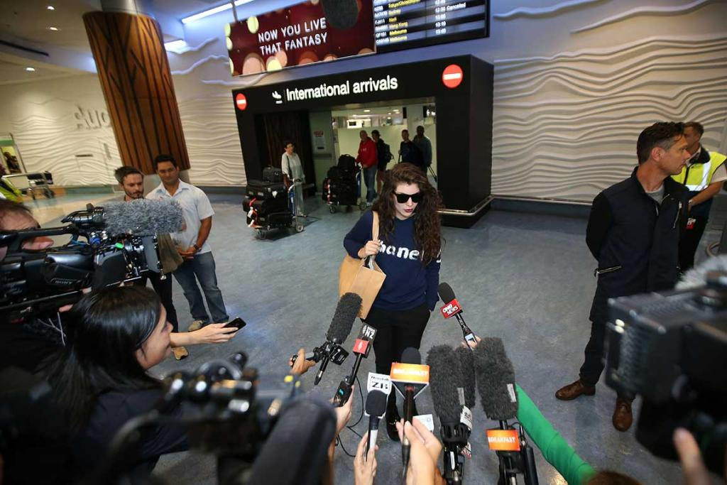 Lorde talking to media after arriving back in New Zealand.