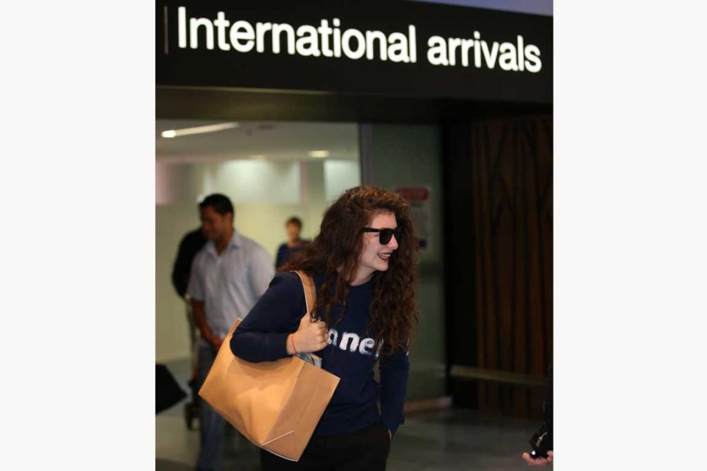 Lorde smiles after arriving in Auckland this morning.