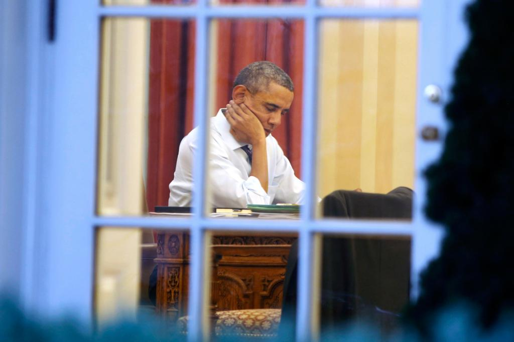 US President Barack Obama sits inside the Oval Office on Monday (local time) as he prepares for his State of the Union Address to the nation on Capitol Hill.