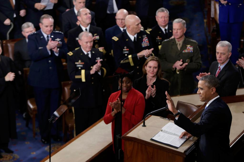 US President Barack Obama acknowledges applause before delivering his State of the Union address in front of the US  Congress.