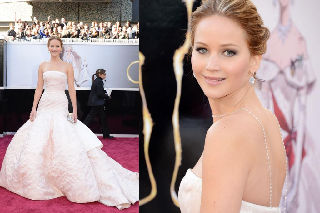 THE PRETTY: Jennifer Lawrence wears a crinkly white Dior Haute Couture gown. Once again she's gone for a frown-shaped strapless neckline, which I'm not a huge fan of, and I hate the backwards necklace. The dress has a certain elegance, yes, and the make-up is lovely, but this look is just too bridal.
