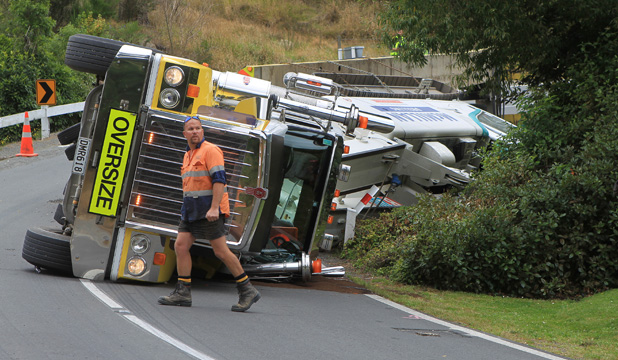 DRIVER SAFE: Shane Reardon was lucky to escape injury after crashing his truck, which was carrying a 65-tonne digger, on a steep bend.