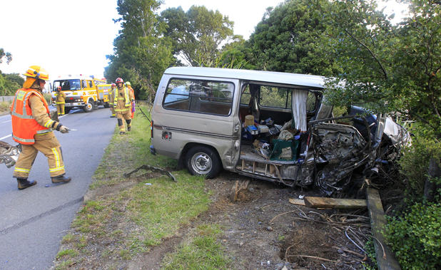 Clean up: Volunteer firefighters clean up after a van and a truck collided on State Highway One at Tuamarina last night.