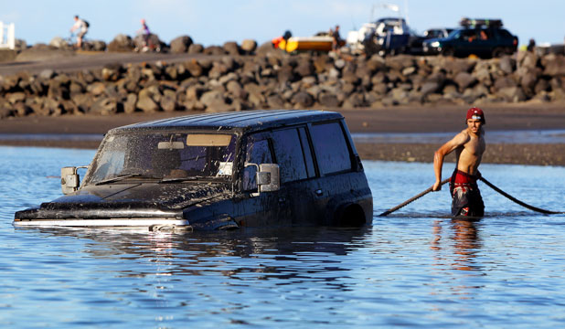 SUV getting stuck in the sea