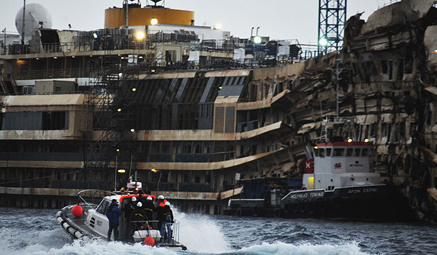 DANGEROUS WRECK: A team of experts go to inspect the wreck of the ship Costa Concordia on January 23, 2014 in Isola del Giglio, Italy.