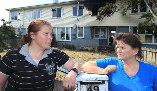 NICK OF TIME: Mother-of-five Jennifer Macgregor, left, with neighbour Suzanne Wilkinson, who helped rescue Ms Macgregor's child from a house fire on Saturday night.