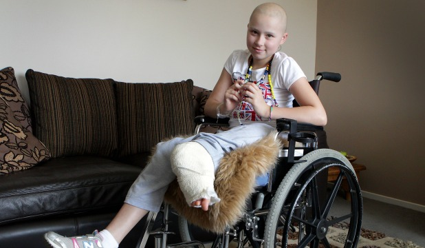 STILL SMILING: Ella Benn, 10 had 14 centimetres of her leg amputated in late January to beat bone cancer. Her foot was reattached backwards for her ankle joint to act as her knee joint.