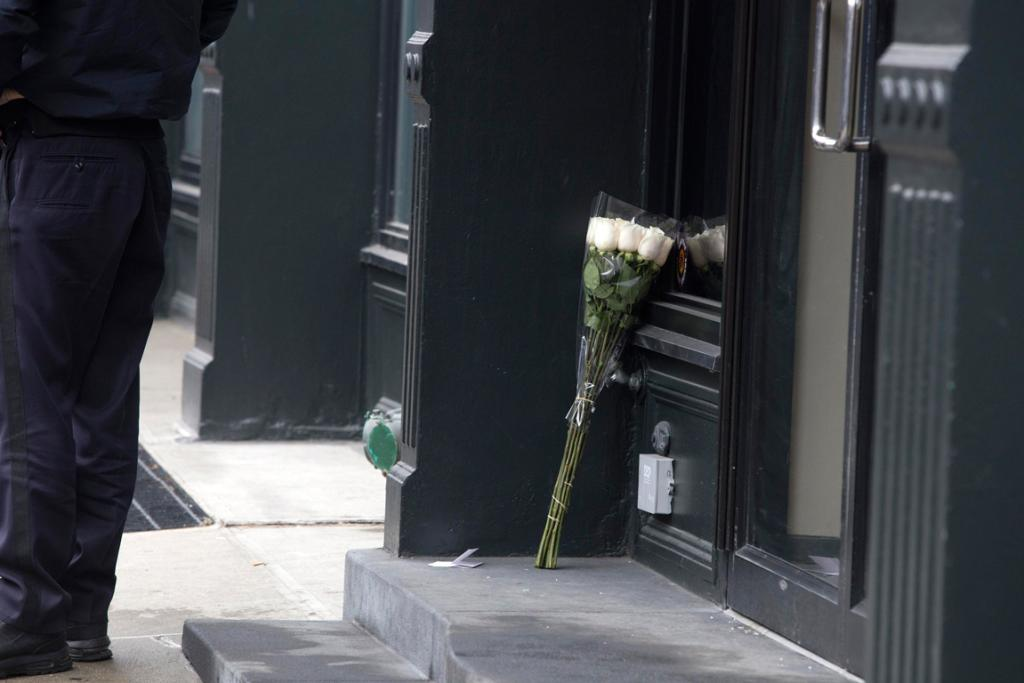 Flowers are placed outside the apartment where actor Philip Seymour Hoffman was found dead in Manhattan, New York.