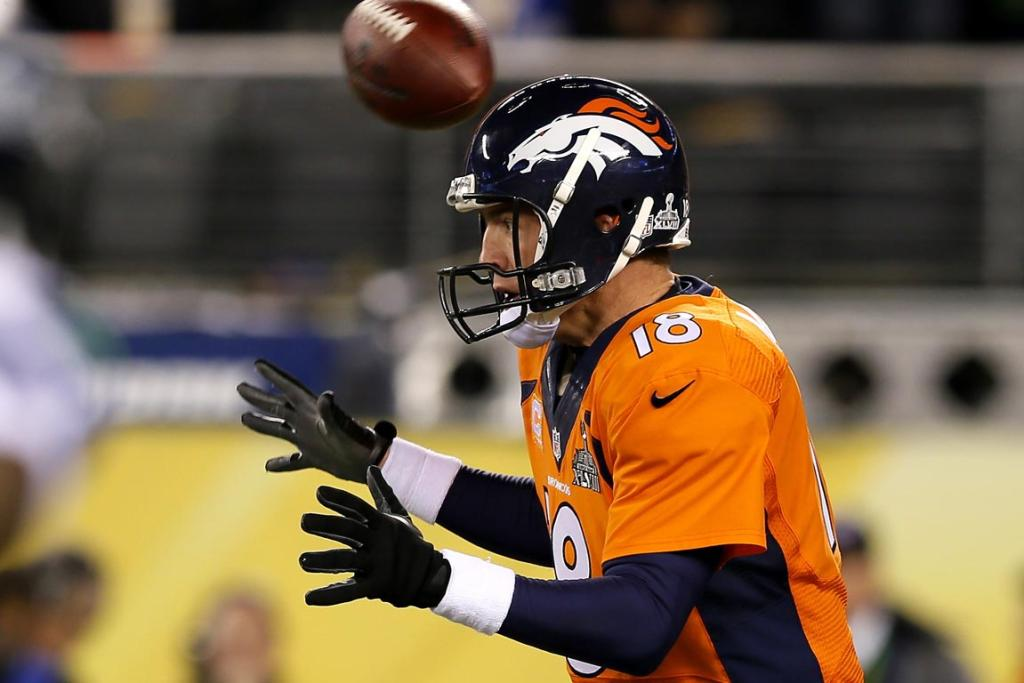The ball flies over the head of quarterback Peyton Manning #18 of the Denver Broncos in the first quarter against the Seattle Seahawks during Super Bowl XLVIII.
