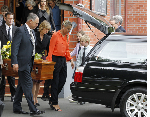 Carrying the coffin to the waiting hearse