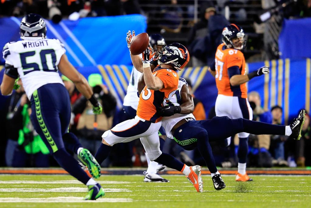 Wide receiver Wes Welker #83 of the Denver Broncos attempts to catch the ball against strong safety Kam Chancellor #31 of the Seattle Seahawks.