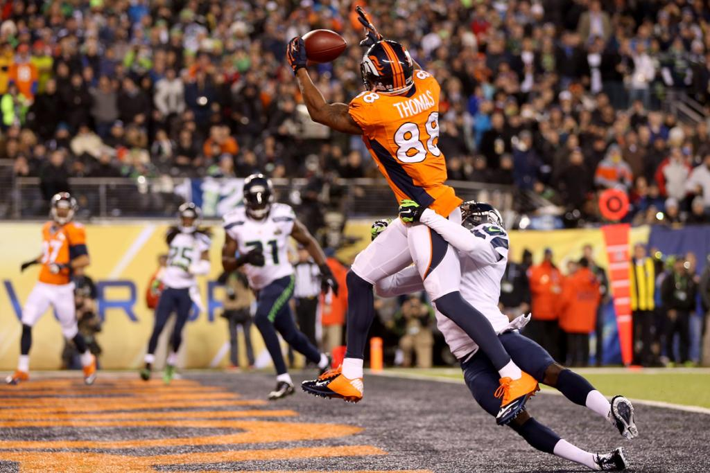 Wide receiver Demaryius Thomas #88 of the Denver Broncos ran 14 yards to score a touchdown in the third quarter against cornerback Byron Maxwell #41 of the Seattle Seahawks.