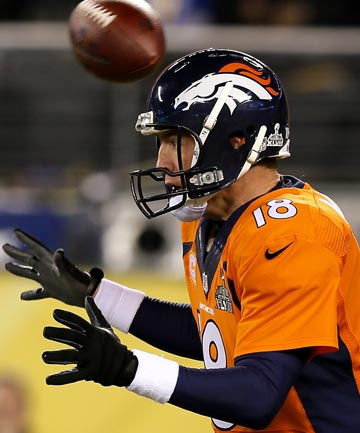SHOCKER: The snap goes over Peyton Manning's head and into the endzone for a safety as the Seahawks score early.