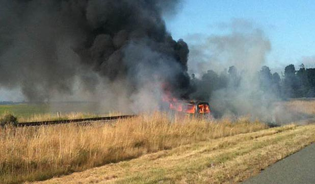 FIRE: A car has burst into flames after crashing on State Highway 1 south of Christchurch.