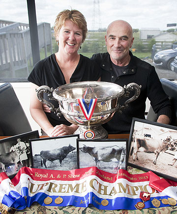 Jersey cow breeders Peter and Kathy Horn with some of the cups and medals won by four generations of the family from their cows at A&P shows.