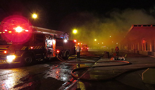 SMOKE SIGNALS: The Salford St shopping centre on fire in Invercargill.