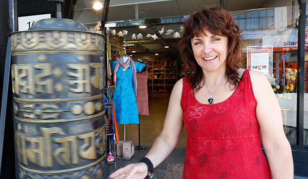FULL CIRCLE: Jayashrii McFadgen with the prayer wheel outside her shop, Himalaya, on Hardy Street after she relocated her store in Nelson from Lyttleton.