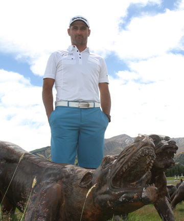 Pivotal player in this year's New Zealand Open golf tournament Michael Hendry stands amongst some of the sculpture installations on Sir Michael Hill's The Hills golf course, home of the tournament.