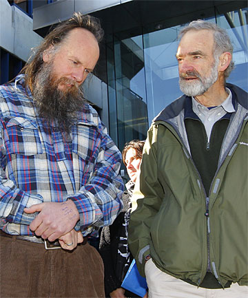 CLAIM OF RIGHT: Adrian Leason, left, and Peter Murnane outside the Wellington High Court where the Crown is trying to get damages from the Waihopai case.